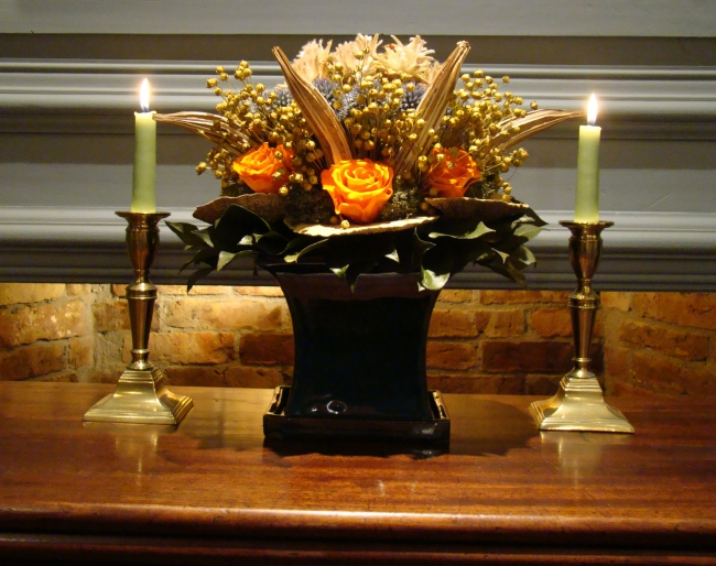 FSquare Teal Pot with plumb Blossom Pods, Blue Billy Balls, Ochre Pods, Tangerine Roses, flax and Mushrooms